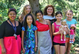 group of girls showing the projects they made at summer sewing camp