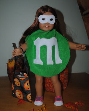 american girl doll in a green mm halloween costume handmade with a white face - How To Make A Doll Costume For Halloween