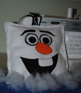 a square white felt olaf the happy snowman face pillow