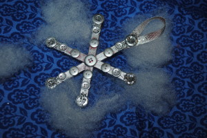 painted silver snowflake made from popsicle sticks and buttons